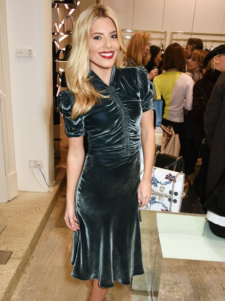 Mollie King wearing a blue velvet dress