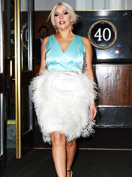 Lady Gaga wearing a feather skirt