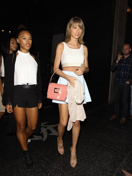 Taylor Swift wearing a white Co ord