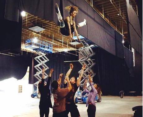 Nicole Scherzinger with cheerleaders