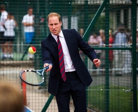 Prince William playing tennis