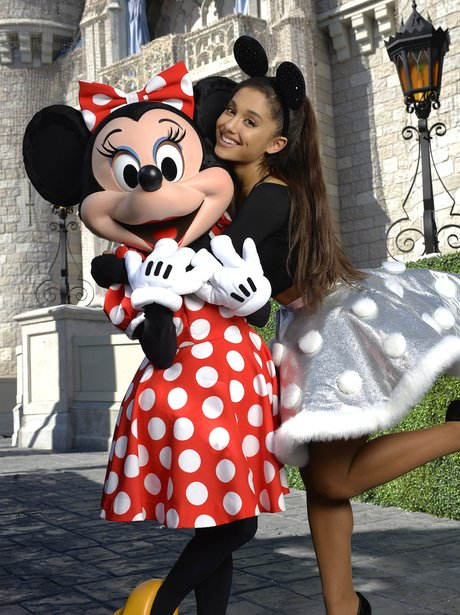 Ariana Grande poses with Minnie Mouse