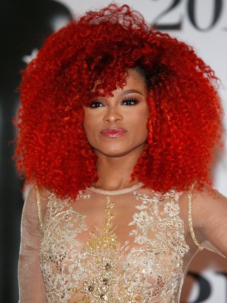 Fleur East at the BRIT Awards with big hair