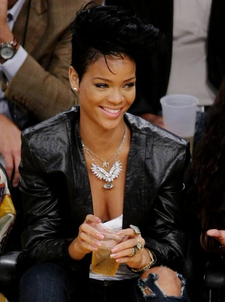 Rihanna with BIG quiff at the basketball