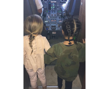 North West and Penelope explore the cockpit of pri