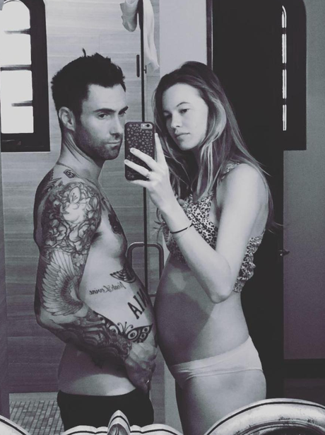 Adam Levine shows off Dad bod