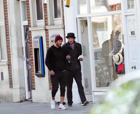 David Beckham gives a homeless man a beer and a bu