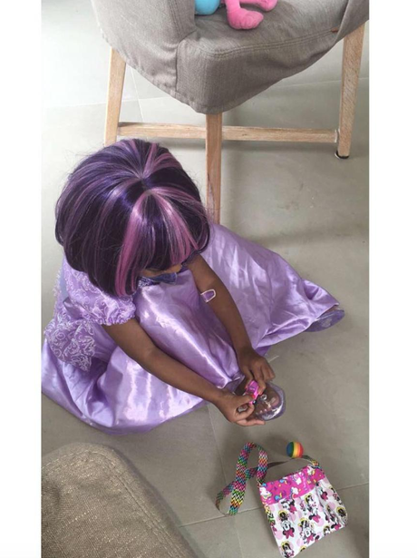North West wears purple wig