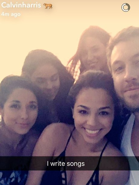 Calvin Harris poses with a group of girls