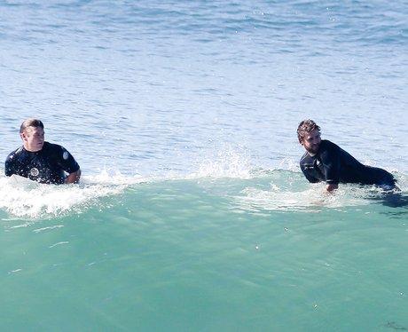 Luke and Liam Hemsworth surfing