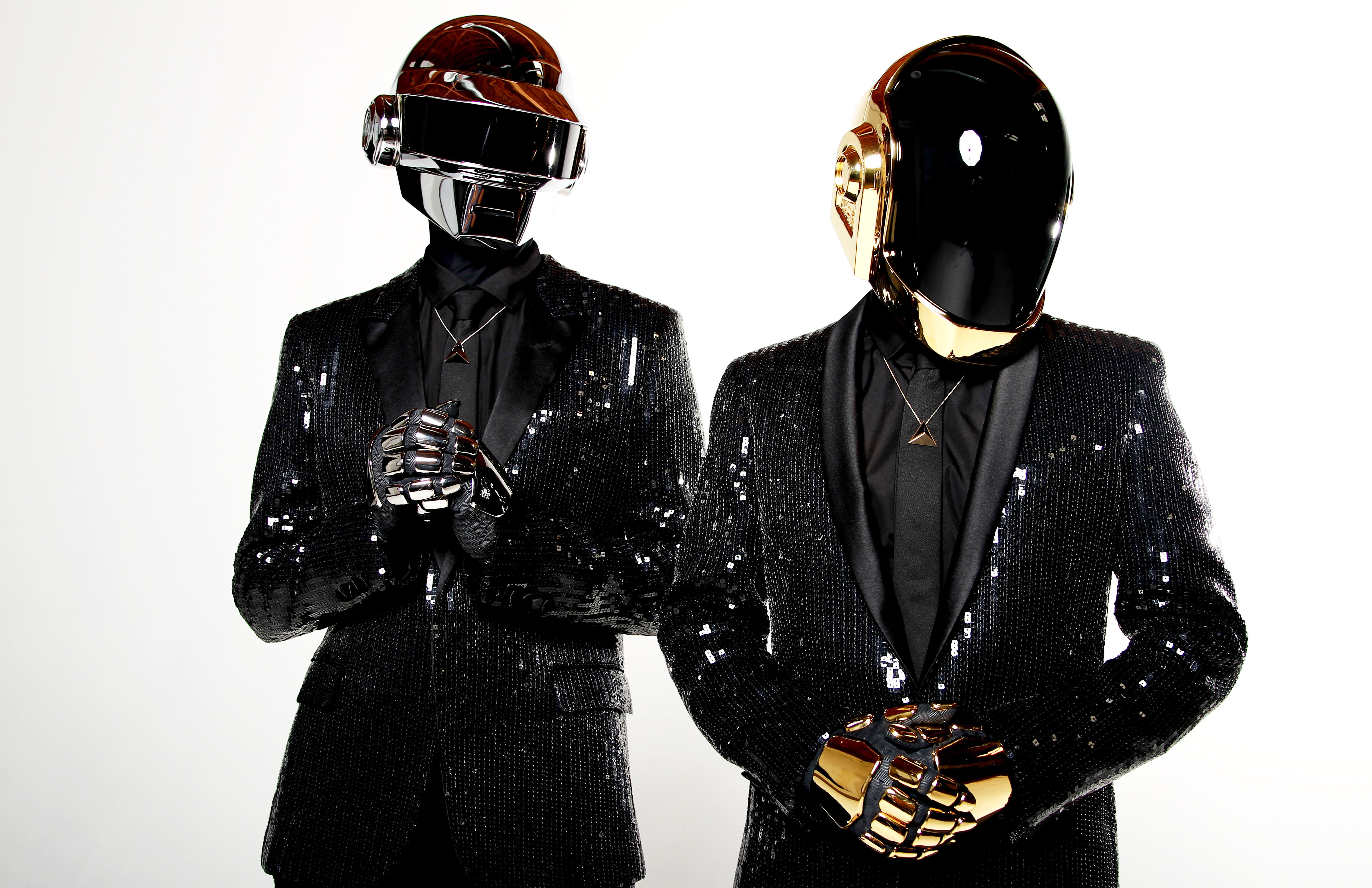 Daft Punk pose for a portrait