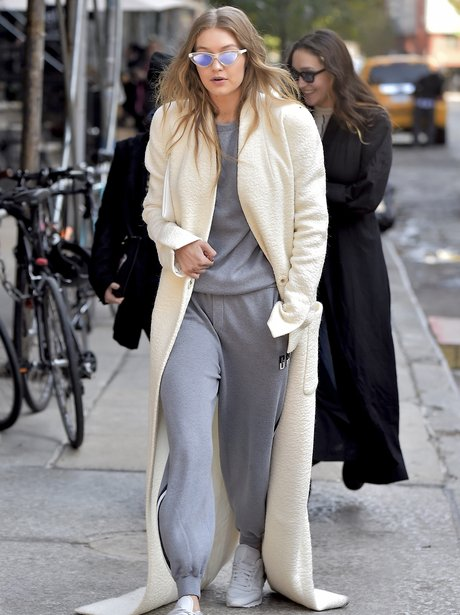 Gigi Hadid Turns The Sidewalk Into Her Own Personal Catwalk In A Floor  Length Coat.
