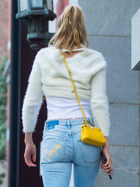 Gigi Hadid wearing jeans with Zayn's name