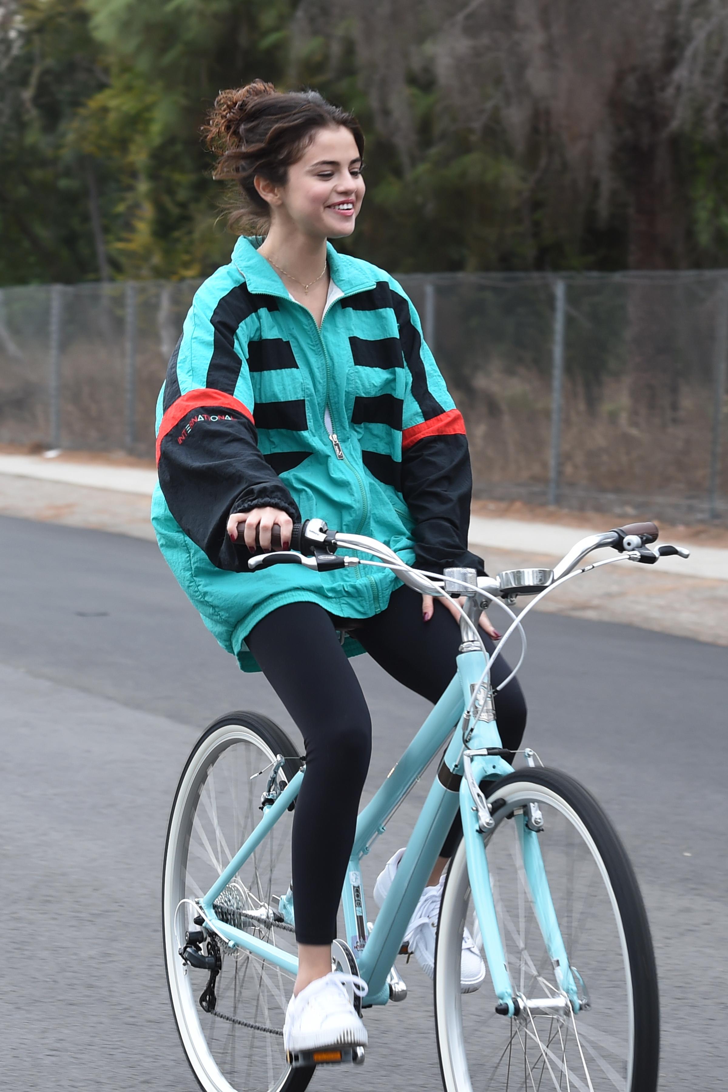 Selena Gomez wearing boyfriends jacket