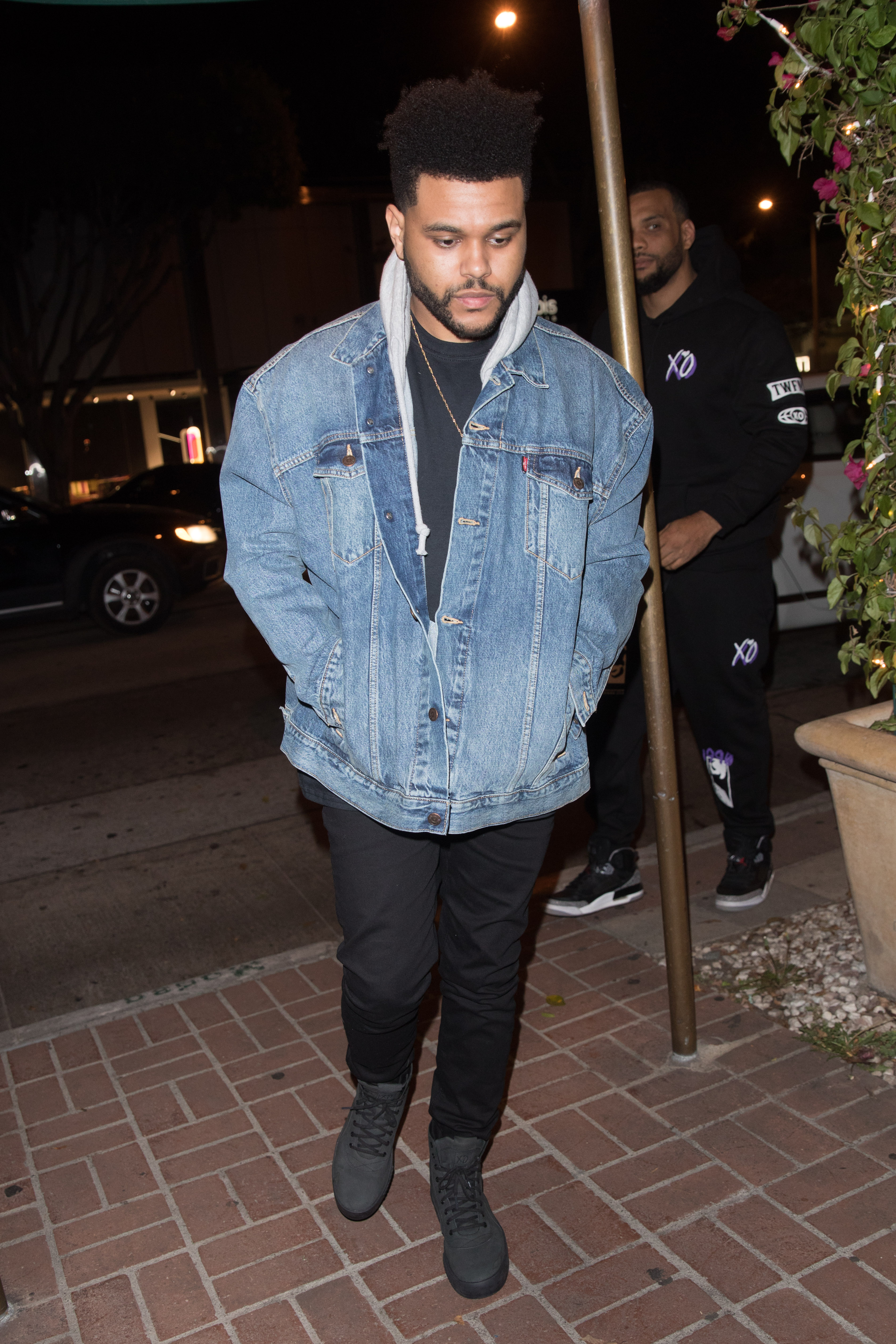 The Weeknd arriving at Madeo Restaurant to meet up