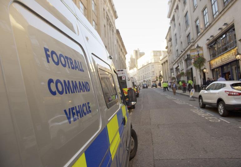 Police football riot van