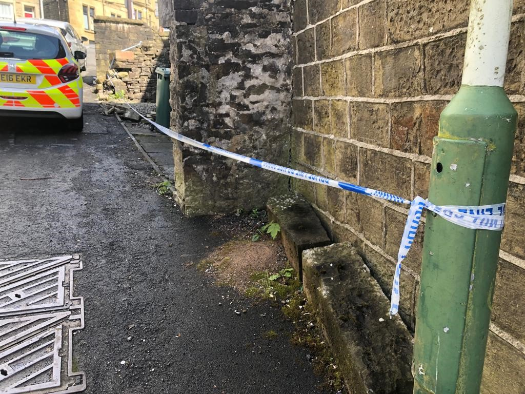 Cordon and police near house in Haslingden