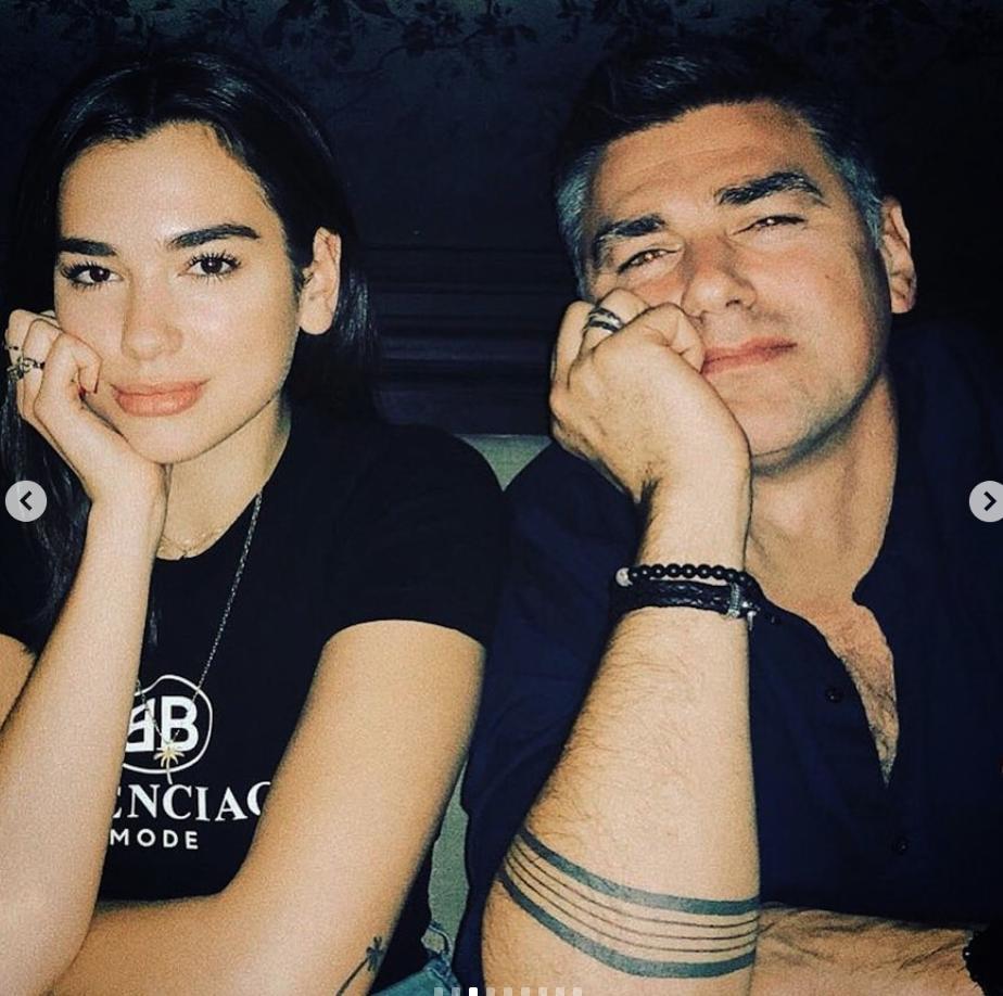 Dua Lipa sits beside her dad