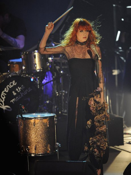 Florence Welch banging a drum