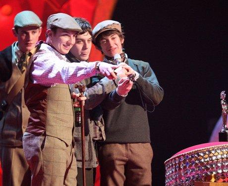 Arctic Monkeys wearing tweed at the BRIT Awards