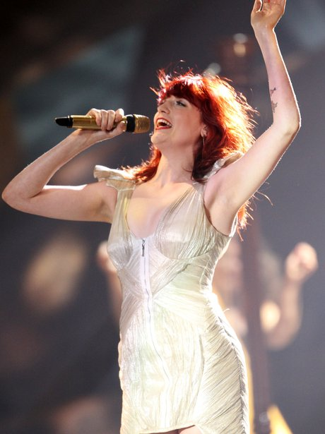 Florence Welch performs live with her band.