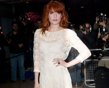 Florence Welch poses for photographers