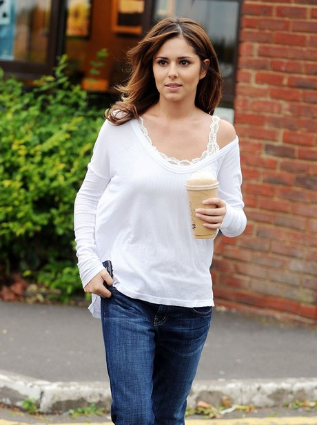 Cheryl Cole wearing a casual white top and blue jeans