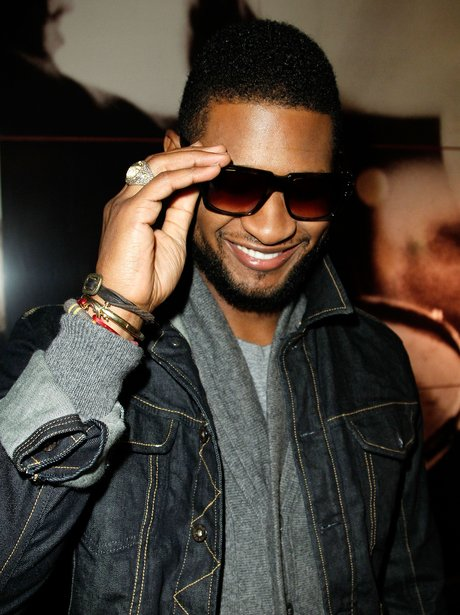Usher with sunglasses on