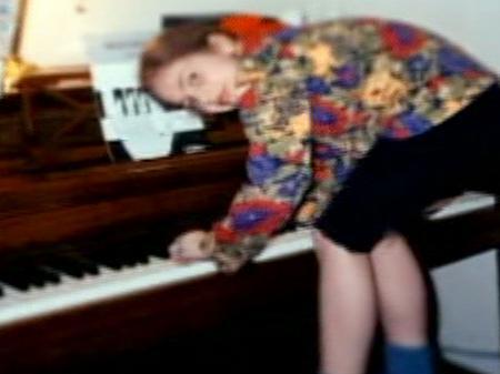 Lady gaga at a young age playing piano