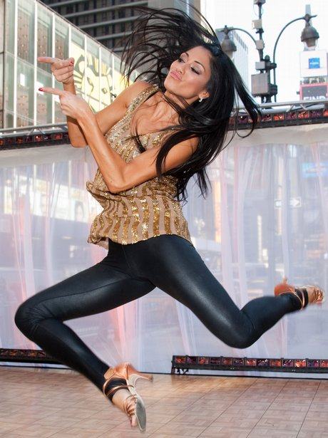 Nicole Scherzinger jumping in the air