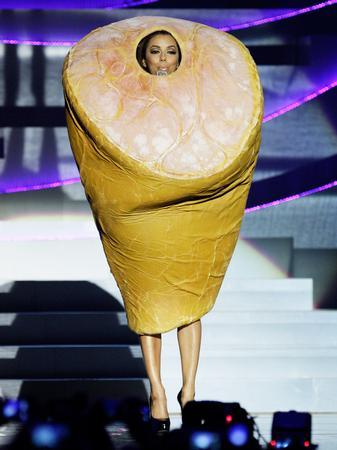 Eva Longoria dresses at the EMAs
