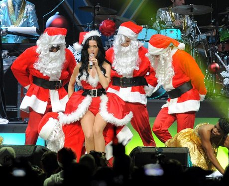 Katy Perry dressed as Mrs. Claus on stage