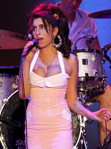 Amy Winehouse performs live on stage