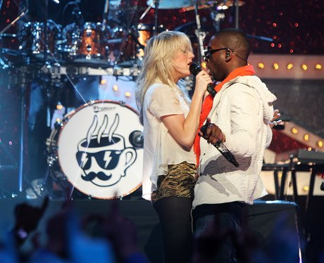 Tinie Tempah and Ellie Goulding perform live
