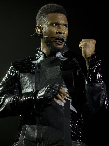 Usher on stage during OMG tour in Manchester