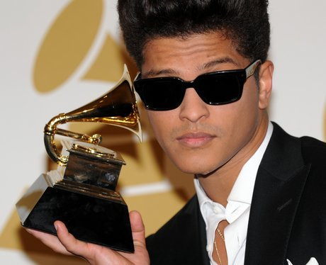 Bruno Mars with his Grammy Award