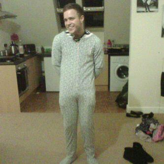 Olly Murs wears a baby grow
