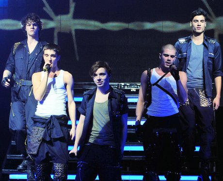 The Wanted performing in vests