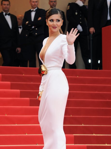 Cheryl Cole at Cannes in white dress with plunging neckline
