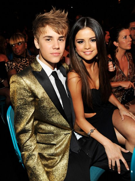 Justin Bieber and girlfriend Selena Gomez in the audience at the Billboard Music Awards