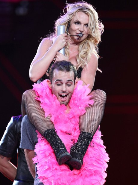 Britney Spears on stage with a fan on 'Femme Fatale' tour