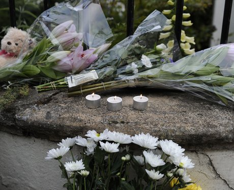 Flowers and messages left outside the home of singer Amy Winehouse following her death at the age of 27