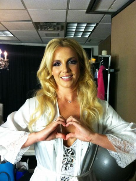 Britney Spears makes a heart shape with her hands in a picture she posted on Twitter