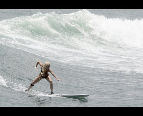 Lady Gaga surfing at sea
