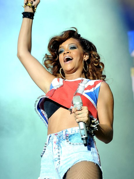 RIhanna in denim shorts and Union Jack crop top