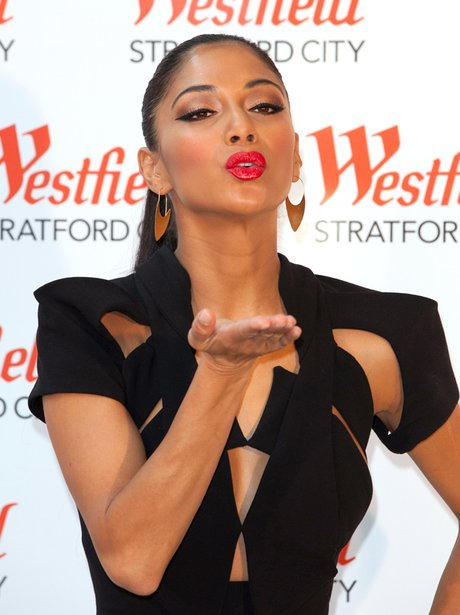 Nicole Scherzinger blowing a kiss
