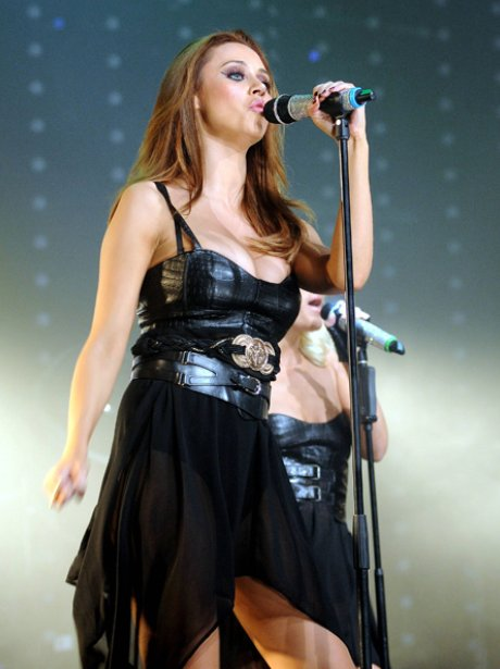 Una Healy on stage in leather