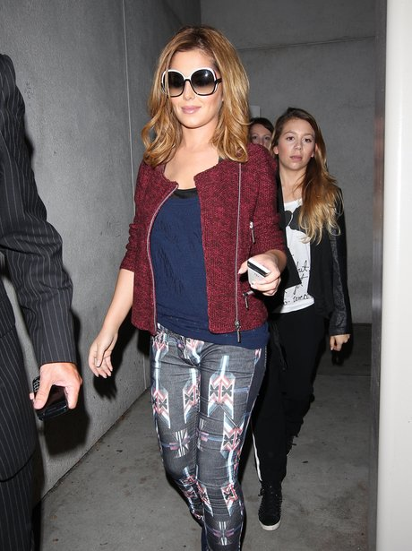Cheryl Cole wears 'The X Factor' trousers as she arrives at LA airport