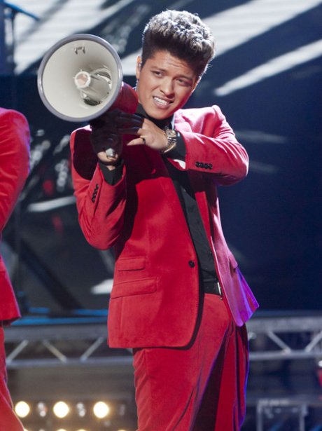 Bruno Mars performing live on stage during The X Factor