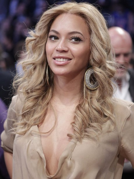 Beyonce with curly blonde hair